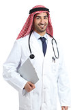 Arab saudi emirates doctor posing holding medical history