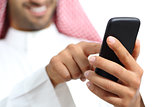 Arab saudi emirates man hand texting in a smart phone