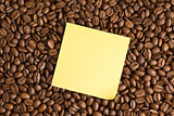 yellow note paper on coffee beans background
