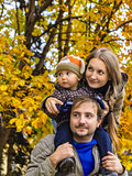 Family in autumn park look