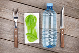 Green salad leaves and water bottle. Healthy food