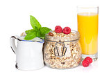 Healthy breakfast with muesli, berries and orange juice