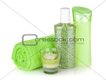 Bathroom bottles, towel and candle