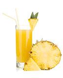 Ripe pineapple and juice glass