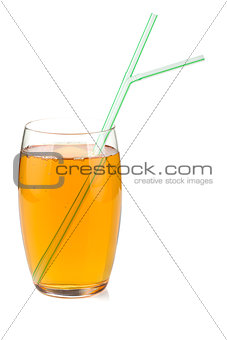 Apple juice in a glass with drinking straws