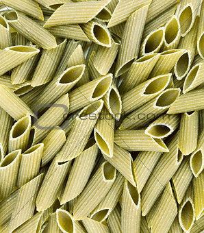 Green colored penne pasta