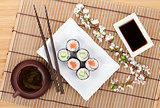 Sushi maki set with salmon and cucumber and green tea