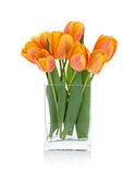Orange tulips in flower bowl