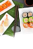 Sushi maki and shrimp sushi on black stone