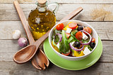 Fresh healthy salad and kitchen utensils