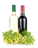 White and red wine bottles and grapes