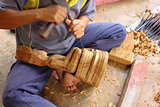 Carving craftsman is carving wood for Buddha model