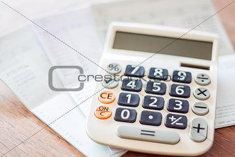 Calculator and bank account passbook