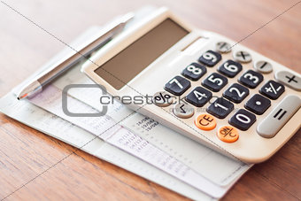 Calculator and pen with bank account passbook