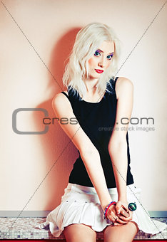 Portrait of cute blonde girl with candy