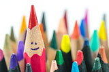 close up of colorful pencils on white background