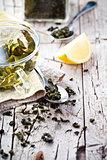 cup of green tea, spoon and lemon