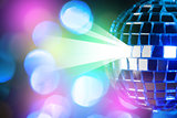 Blue shiny disco ball on Colorful bokeh background