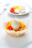 Hard boiled quail eggs with capsicum in cheese basket