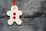 Generic machine made Christmas gingerbread man ornament on rusti