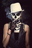 Woman with skeleton face art smoking