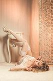 Beautiful blond woman lying indoors