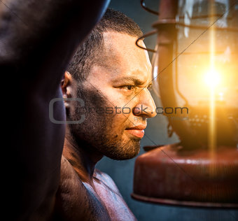 Portrait of young man with oil lamp