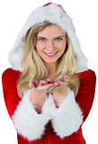 Pretty girl in santa outfit with hands out