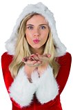 Pretty girl in santa outfit blowing