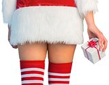 Pretty girl in santa outfit holding gift