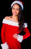 Pretty brunette in santa outfit smiling at camera