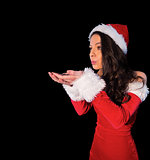 Pretty brunette in santa outfit blowing over her hands