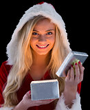 Pretty blonde in santa outfit opening gift