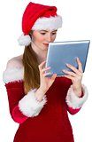 Pretty santa girl using tablet pc