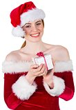 Pretty girl in santa costume holding gift box