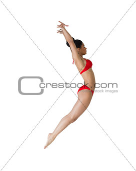 Fit girl in red bikini leaping