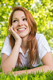 Pretty redhead relaxing in the park