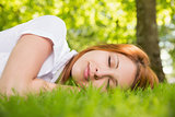Pretty redhead lying on the grass