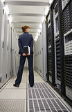Technician standing in server hallway