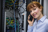 Technician talking on phone while analysing server