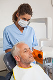 Dentist taking an xray of patients mouth