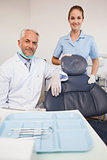 Dentist and assistant smiling at camera