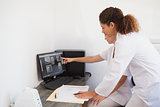 Dentist and assistant studying x-rays on computer