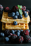 Waffles and fruit.