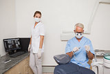 Dentist and assistant getting ready for patient