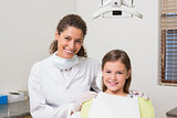 Little girl smiling at camera with her pediatric dentist