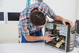 Computer engineer working on broken console
