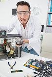 Stressed computer engineer showing broken fan