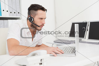 Call center agent on a call at his desk