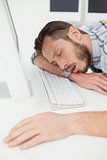 Sleeping casual businessman at his desk